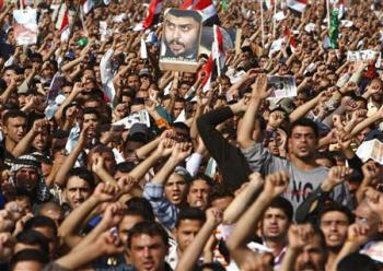 Demonstrators make their voices heard during a rally at Firdos square in Baghdad November 21, 2008. (REUTERS/Ceerwan Aziz)